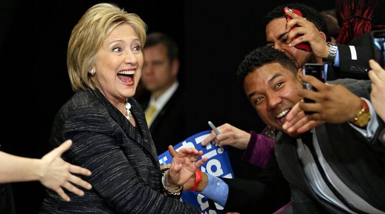 Democratic presidential candidate, Hillary Clinton takes selfies with supporters before speaking during a rally at Cuyahoga Community College Tuesday, March 8, 2016, in Cleveland. (AP Photo/Tony Dejak)