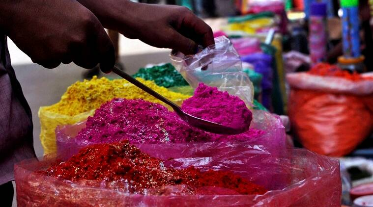 Guwahati: A vendor sells Holi colours at Fancy Bazar in Guwahati on Tuesday. PTI Photo (PTI3_22_2016_000111A)