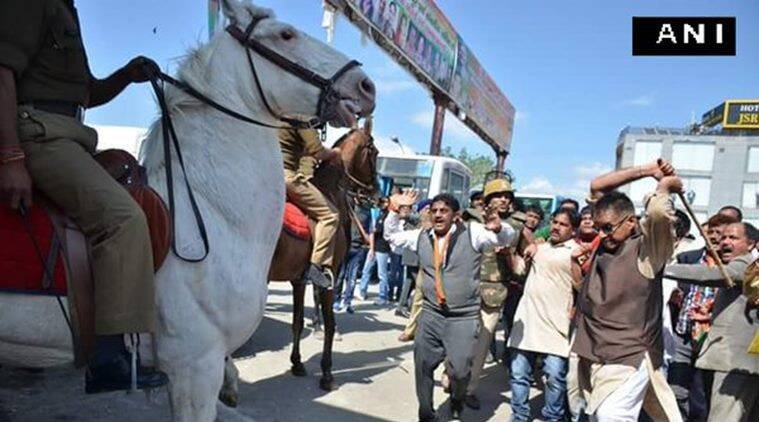 BJP MLA lathicharging a police horse in Dehradun on Monday. ANI photo