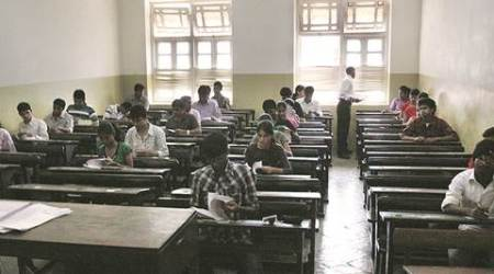 """HSC students appear for their first board paperat an exam centre at R A Podar college, Matunga. The HSC exam began"" *** Local Caption *** ""HSC students appear for their first board paperat an exam centre at R A Podar college, Matunga. The HSC exam began on Tuesday. Express Photo By Pradeep Kocharekar mumbai-21-02-2012"""