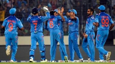 India's fielders congratulate teammate Bhuvneshwar Kumar (C) after he dismissed Pakistan's captain Mohammad Hafeez successfully during their match of ICC Twenty20 World Cup at the Sher-E-Bangla National Cricket Stadium in Dhaka March 21, 2014. REUTERS/Andrew Biraj (BANGLADESH - Tags: SPORT CRICKET)