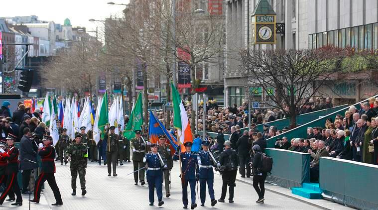 Thousands of soldiers march solemnly through the streets of Dublin, Ireland, Sunday, March, 27, 2016.  Thousands of people took part in the 100th anniversary of Ireland's Easter Rising against Britain, a doomed rebellion that reduced parts of the capital to ruins and inspired the country's eventual independence.  (AP Photo/Peter Morrison)