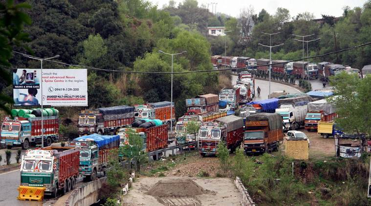 Jammu: Stranded trucks on Jammu-Srinagar National Highway closed for traffic after massive landslides blocked the road in Jammu on Thursday. PTI Photo (PTI3_17_2016_000137A)