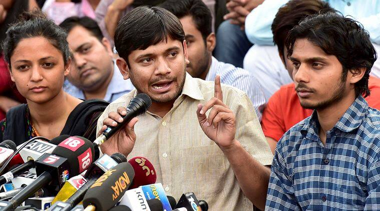 JNUSU President Kanhaiya Kumar with the union Vice President Shehla Rashid (L) and Rama Naga (R) who is facing sedition charges, addresses a news conference at the JNU campus in New Delhi on Friday. PTI Photo