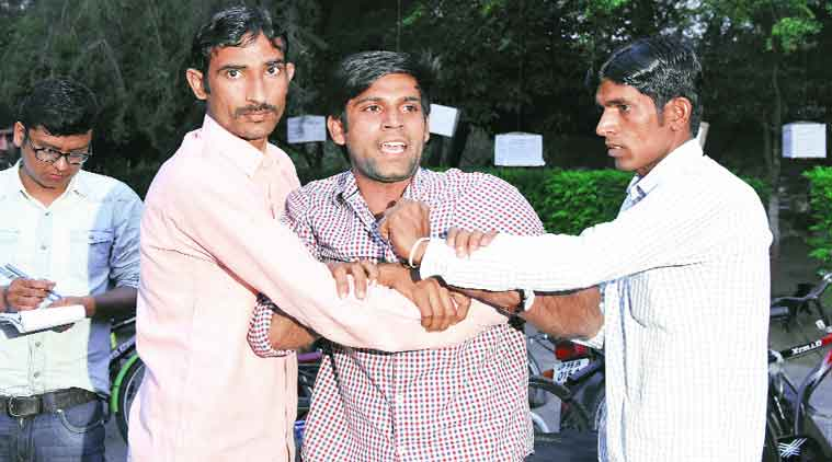 Vikas Chaudhary was handed over to the police. (Express Photo)