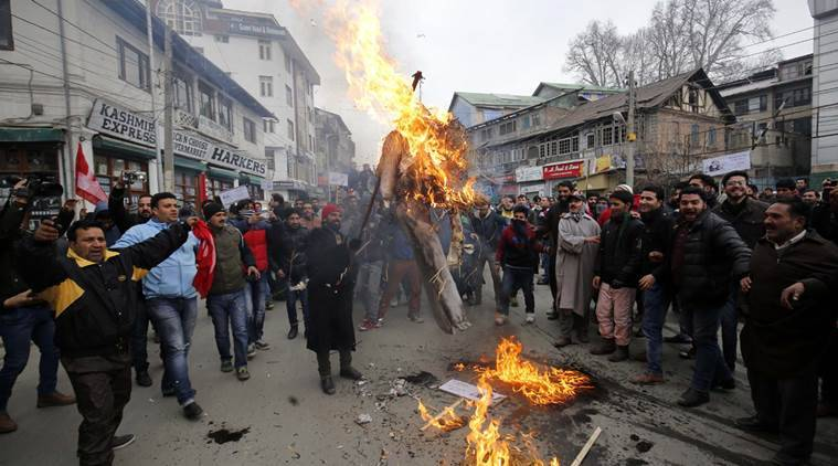 Supporters of Kashmir's main opposition party National Conference (NC) burn an effigy of region's PDP-BJP coalition government during a protest march in Srinagar. Police detained youth wing president of National Conference alongwith dozen of party supporters for protesting against the implementation of National Food security Act (NFSA) in the region. According to NFSA, people will get five kilogram per person of subsidised ration against the previous 30 kg per family. Express Photo by Shuaib Masoodi 23-12-2015 *** Local Caption *** Supporters of Kashmir's main opposition party National Conference (NC) burn an effigy of region's PDP-BJP coalition government during a protest march in Srinagar. Police detained youth wing president of National Conference alongwith dozen of party supporters for protesting against the implementation of National Food security Act (NFSA) in the region. According to NFSA, people will get five kilogram per person of subsidised ration against the previous 30 kg per family. Express Photo by Shuaib Masoodi 23-12-2015