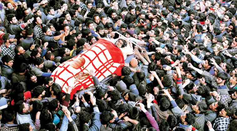 The body of Dawood Ahmad Sheikh, a Hizbul Mujahideen militant, is taken for burial Monday. (Source: AP)