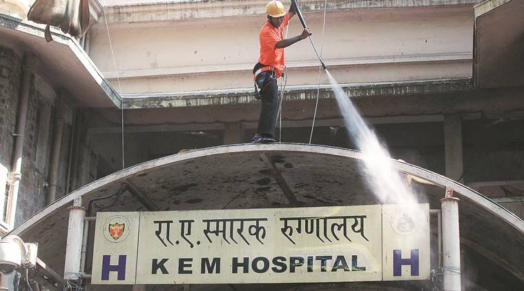 Sweepers indulge in cleaning the entire premise of KEM hospital. More than a lakh patients visit the civic-run hospital for treatment on a daily basis on Sunday. Express Photo by Pradeep Kocharekar. 10.11.2013. Mumbai.