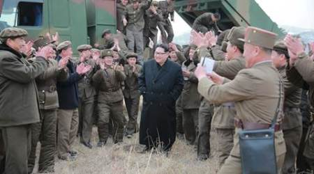 North Korean leader Kim Jong Un (C) smiles as he guides a test fire of a new multiple launch rocket system in this undated photo released by North Korea's Korean Central News Agency (KCNA) in Pyongyang March 4, 2016.    REUTERS/KCNA ATTENTION EDITORS - THIS PICTURE WAS PROVIDED BY A THIRD PARTY. REUTERS IS UNABLE TO INDEPENDENTLY VERIFY THE AUTHENTICITY, CONTENT, LOCATION OR DATE OF THIS IMAGE. FOR EDITORIAL USE ONLY. NOT FOR SALE FOR MARKETING OR ADVERTISING CAMPAIGNS. THIS PICTURE IS DISTRIBUTED EXACTLY AS RECEIVED BY REUTERS, AS A SERVICE TO CLIENTS. NO THIRD PARTY SALES. SOUTH KOREA OUT. NO COMMERCIAL OR EDITORIAL SALES IN SOUTH KOREA