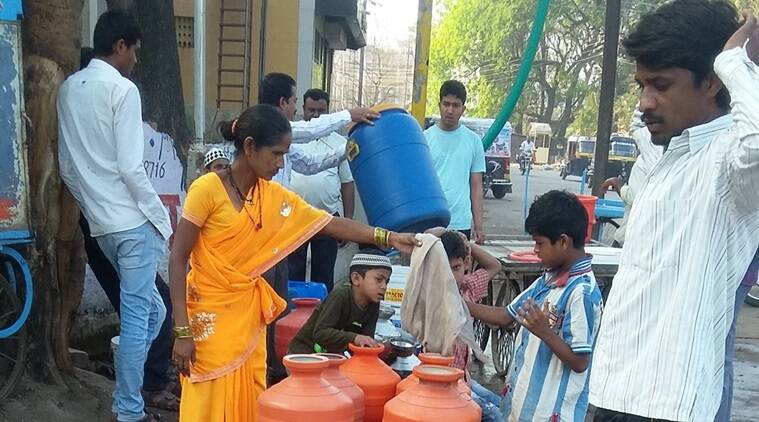 People struggle to get water in Latur. Express photo
