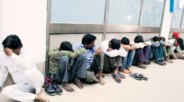 Victims wait for medical tests at BJ Medical College in Ahmedabad on Tuesday. (Express Photo: Javed Raja)