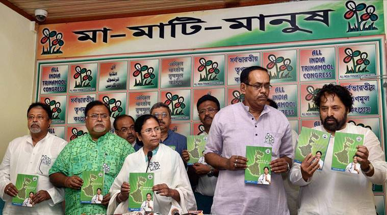Kolkata: TMC cand West Bengal Chief Minister Mamata Banerjee with party leaders during the release of her party's manifesto in Kolkata on Friday for the upcoming State Assembly elections. PTI Photo by Swapan Mahapatra(PTI3_11_2016_000210B)