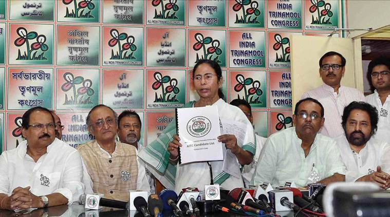 Kolkata: West Bengal Chief Minister and Trinamool Congress Supremo Mamata Banerjee with party leaders during the release of the party's list of candidates for the upcoming Assembly elections, in Kolkata on Friday. PTI Photo(PTI3_4_2016_000226A)