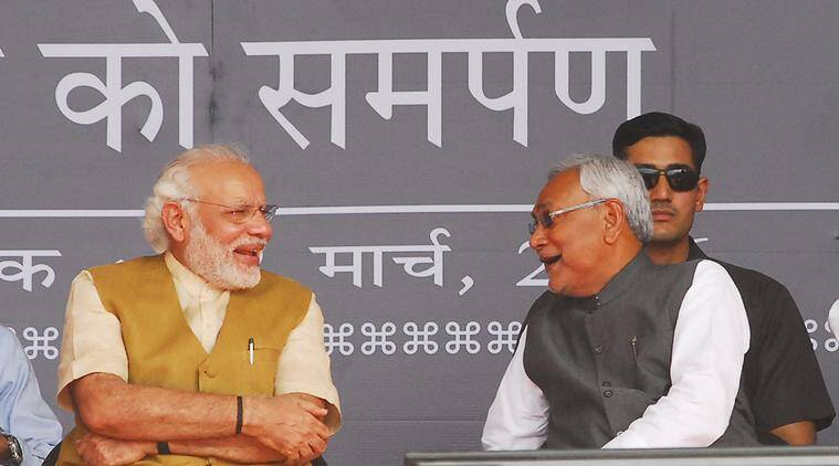 Prime Minister Narendra Modi share light mood with CM Nitish Kumar during the Railway Program in Hajipur on Saturday, March 12,2016. Express Photo By Prashant Ravi