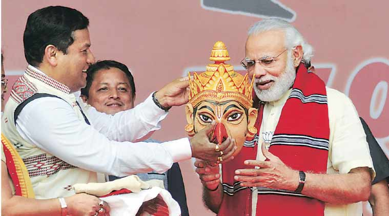 PM Modi with BJP's CM candidate Sarbananda Sonowal  at Majuli in Assam Saturday. (Express Photo: Dasarath Deka)