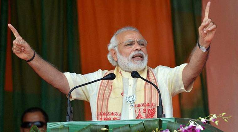 Tinsukia : Prime Minister Narendra Modi addresses an election rally at Tinsukia, Assam on Saturday. PTI Photo (PTI3_26_2016_000068B) *** Local Caption ***