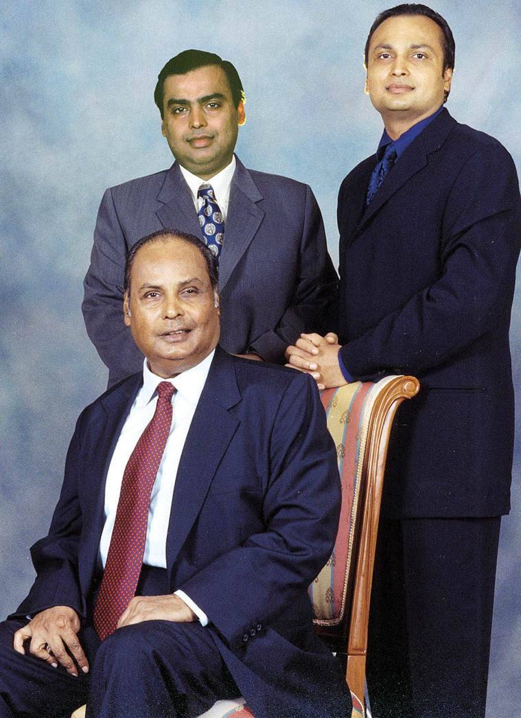 Dhirubhai Ambani (seated) with his two sons at their Mumbai residence in this file photo. Dhirubhai passed away in 2002. Reuters