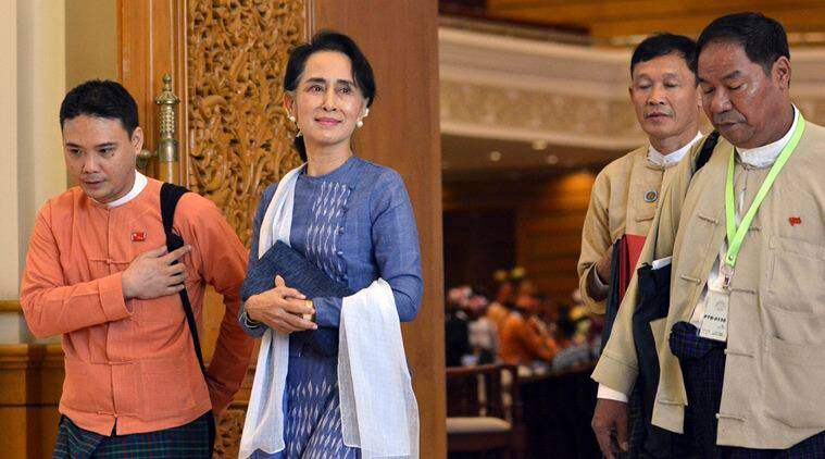 In this Friday, March 11, 2016 photo, National League for Democracy (NLD) party leader Aung San Suu Kyi, second left, leaves Parliament building in Naypyitaw, Myanmar. A longtime confidante of Suu Kyi was confirmed Friday in a parliamentary vote as one of the three final candidates to be Myanmar's next president, albeit as a proxy for the Nobel laureate. (AP Photo/Aung Shine Oo, File)