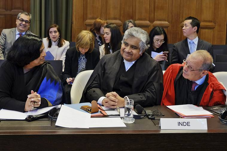 Members of the Indian delegation Neeru Chadha, left, Harish Salve, center and Alain Pellet, right, wait for the start of a preliminary hearing on nuclear disarmament at the International Court of Justice in The Hague, Netherlands. AP Photo