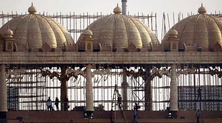 New Delhi:  Workers prepare stage for the three-day World Peace Festival organised by spiritual guru Sri Sri Ravi Shankar in New Delhi on Tuesday.  PTI Photo by Kamal Kishore (PTI3_8_2016_000256A)