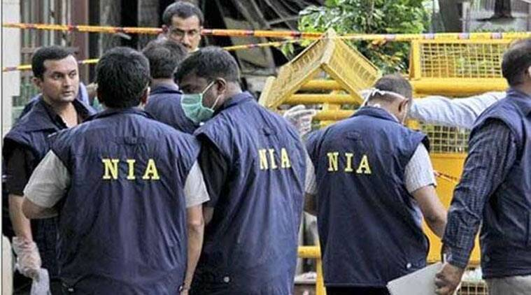 NIA officials in this file photo.