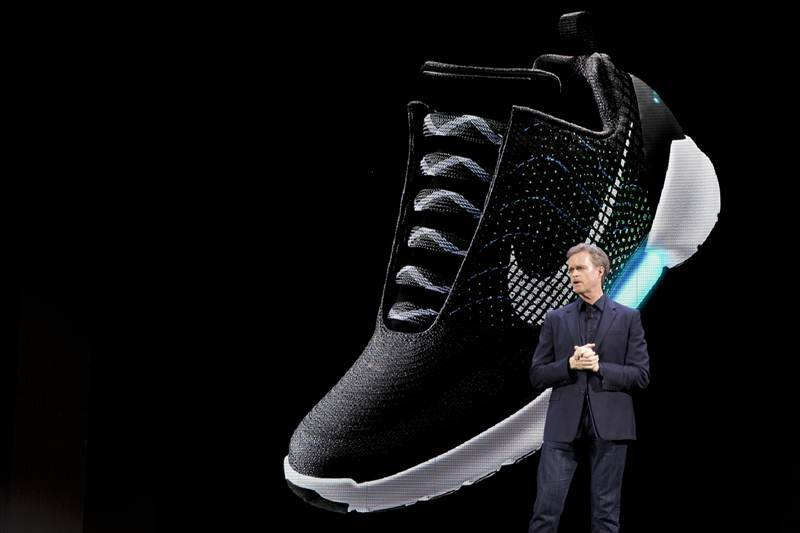 Nike has unveiled its first power-lacing sneaker - it allows users to make the fit looser or snugger on the fly by pressing buttons on the side of the shoe (Source: AP)