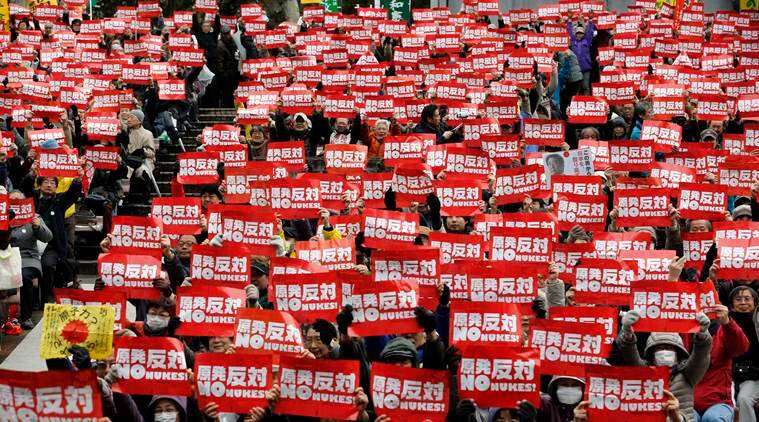 "Anti-nuclear protesters hold ""No nukes"" placards during a rally, calling for the government to put an end to atomic power in Japan. File anti-nuclear protesters hold ""No nukes"" placards during a rally, calling for the government to put an end to atomic power in Japan. File/AP"