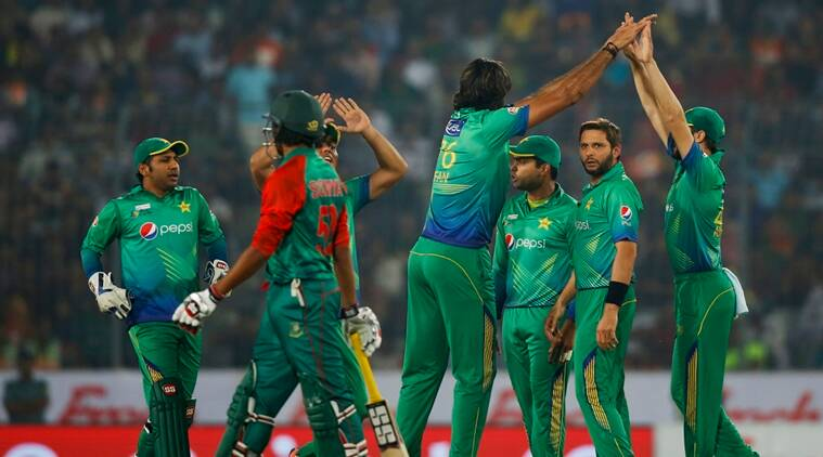 Pakistan's Mohammad Irfan, center, celebrates with his teammates after the dismissal of Bangladesh's Tamim Iqbal, second left, during their Asia Cup Twenty20 international cricket match in Dhaka, Bangladesh, Wednesday, March 2, 2016. (AP Photo/A.M. Ahad)