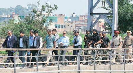 Pathankot attack: Arriving to protests, Pak investigators retrace route terrorists took toairbase