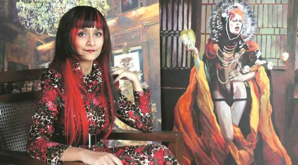 Pracheta Banerjee with one of her artworks in the background (Express photo by Partha Paul)
