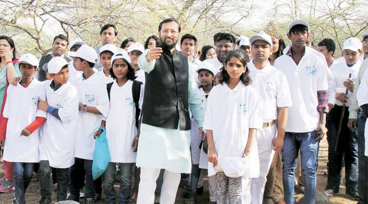Environment and Forests Minister Prakash Javadekar with students at the Asola Bhatti Wildlife Sanctuary Monday. (Expres Photo: Renuka Puri)
