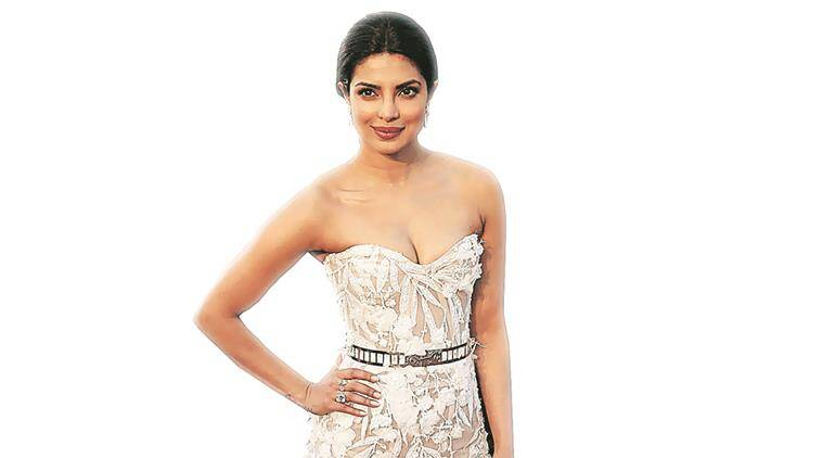 Presenter Indian actress Priyanka Chopra wearing a white Zuhair Murad gown arrives at the 88th Academy Awards in Hollywood, California February 28, 2016.  REUTERS/Lucas Jackson