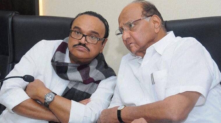 Mumbai: NCP President Sharad Pawar with party leader Chhagan Bhujbal during a meeting with the party workers of Thane district in Mumbai on Wednesday. PTI Photo (PTI7_1_2015_000139B) *** Local Caption ***