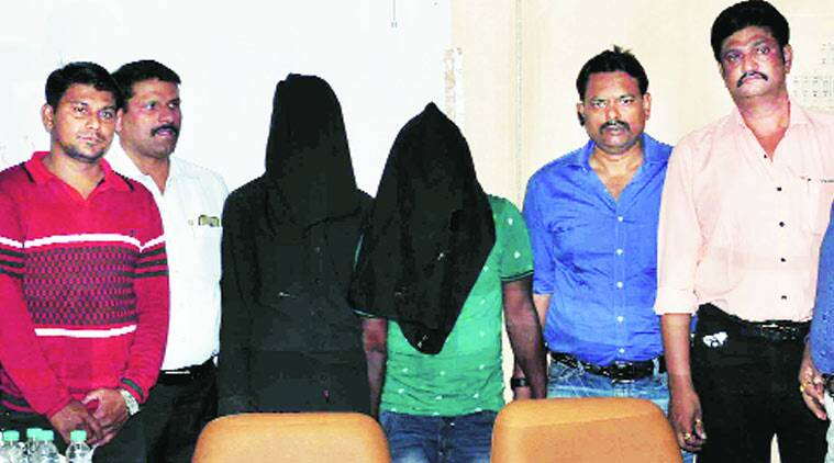Arrested suspects Kharade and Rathod at Pune Police Commissionerate on Saturday. Express Photo