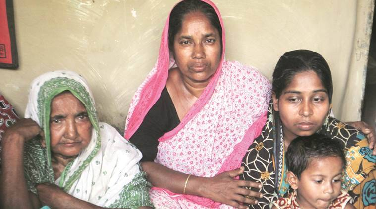 Farida Bibi (extreme left), wife of Rezaul Islam (below) who was killed in police firing, with other family members at their home, in Illambazar on Wednesday.  Subham Dutta