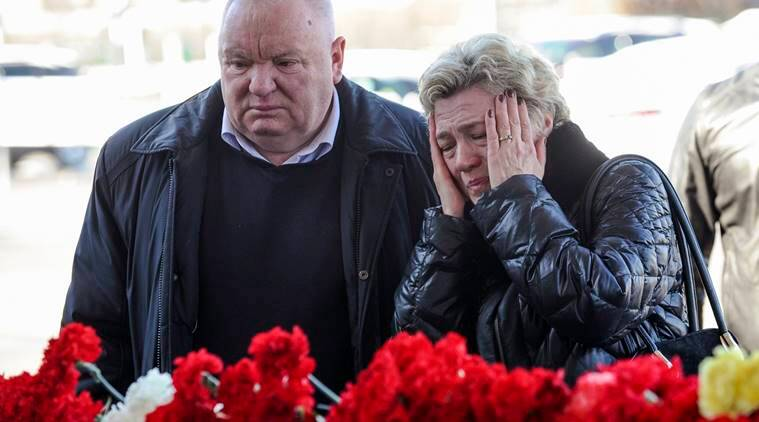 People mourn for the victims of the crashed FlyDubai plane at the Rostov-on-Don airport, about 950 kilometers (600 miles) south of Moscow, Russia, Sunday, March 20, 2016. Winds were gusting before dawn Saturday over the airport in the southern Russian city of Rostov-on-Don when the plane carrying 62 people from a favorite Russian holiday destination decided to abort its landing. (AP Photo)