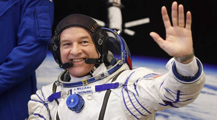 NASA astronaut Jeff Williams, member of the main crew of the expedition to the International Space Station (ISS), waves prior to the launch of Soyuz TMA-20M space ship at the Russian leased Baikonur cosmodrome, Kazakhstan, Friday, March 18, 2016. (AP Photo/Dmitri Lovetsky)