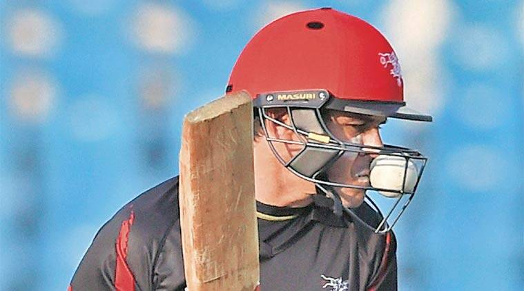 Hong Kong batsman Ryan Campbell finds his helmet crowded by something it is supposed to keep out — the ball. (Source: PTI)