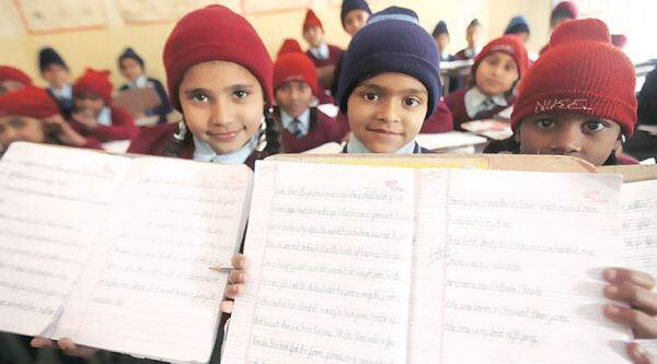 Students at Govt. Primary school at village Rattoke in Sangrur. (Express Photo by Gurmeet Singh)