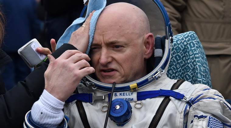 International Space Station (ISS) crew member Scott Kelly of the U.S. reacts after landing near the town of Dzhezkazgan, Kazakhstan, on Wednesday, March 2, 2016. US astronaut Scott Kelly and Russian cosmonaut Mikhail Kornienko returned to Earth on March 2 after spending almost a year in space in a ground-breaking experiment foreshadowing a potential manned mission to Mars. (Krill Kudryavtsev/Pool photo via AP)