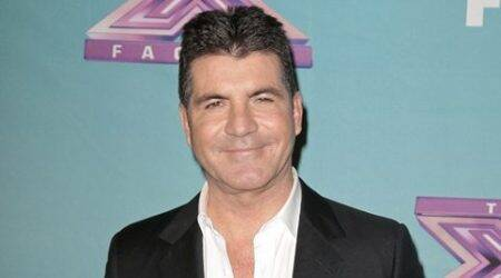 Simon Cowell's son is his right-hand man
