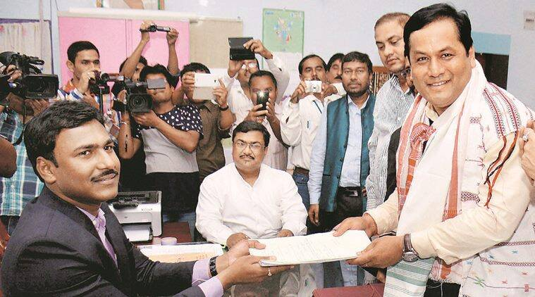 Majuli: BJP CM candidate & Union Minister for Youth and Sports Affairs and State President Sarbananda Sonowal filing his nomination papers at DC office ahead of Assam elections in Majuli on Wednesday. PTI Photo (PTI3_16_2016_000067B)