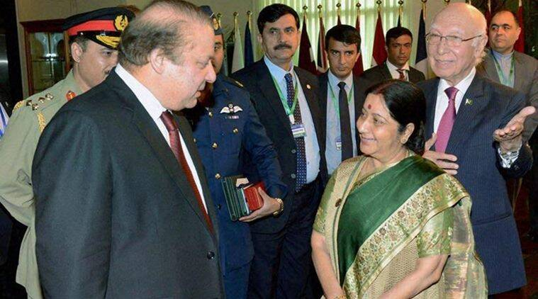 Islamabad: External Affairs Minister Sushma Swaraj with Pakistan Prime Minister Nawaz Sharif as Pakistan's Foreign Affairs Adviser Sartaj Aziz looks on during the Ministerial Conference of Heart of Asia - Istanbul Process in Islamabad on Wednesday. PTI Photo(PTI12_9_2015_000159B)