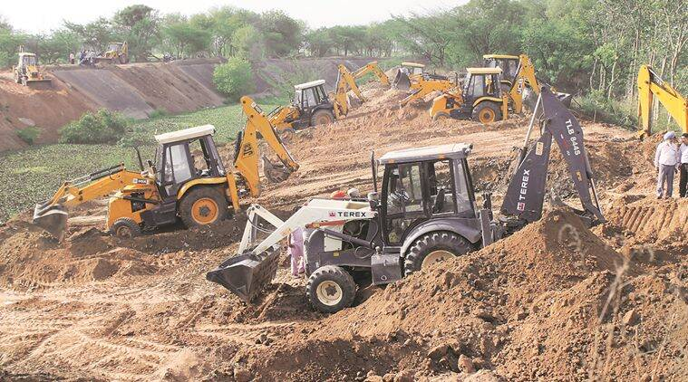 LABOURER to smeared with soil at the SYL CALLAL.s ditch with the help of cranes near rajpura in patiala SAD AND CONGRESS workers werealso present there  on wednesday express photo by harmeet sodhi