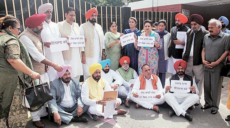 Punjab Congress MLAs sit in front of  Raj Bhawan before meeting Governor Kaptan Singh Solanki, in Chandigarh on Wednesday. Kamleshwar Singh
