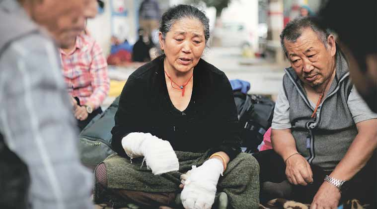 Nyima Yangzom, mother of Dorjee Tsering, suffered minor burn injuries when she tried to save him. (Express Photo: Praveen Khanna)
