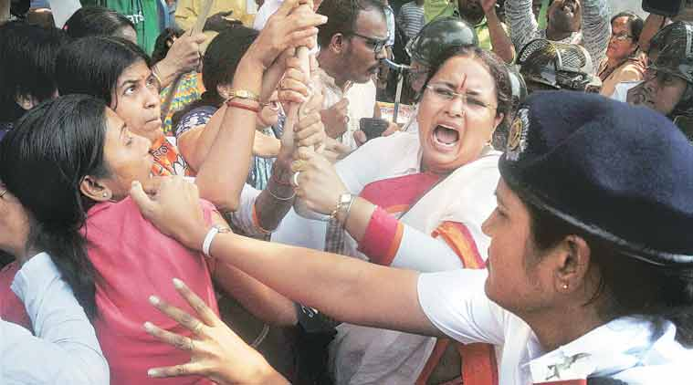 BJP workers scuffle with police during a protest against the government in Kolkata on Wednesday. (Spurce: PTI)