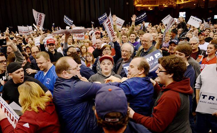 A protester, center left, and a Trump supporter, center right, scuffle during a rally for Republican presidential candidate Donald Trump Saturday, March, 12, 2016, held at the I-X Arena in Cleveland, Ohio. (Michael Henninger/Pittsburgh Post-Gazette via AP)