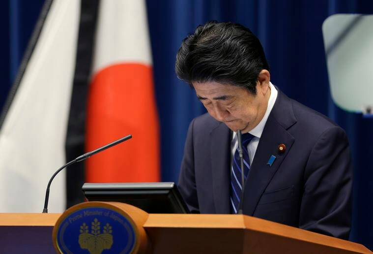 Japanese Prime Minister Shinzo Abe bows at the start of a press conference at his official residence in Tokyo, Thursday, March 10, 2016, on the eve of the fifth anniversary of the March 11, 2011 earthquake and tsunami. Abe has pledged to bolster reconstruction efforts in tsunami-hit northern Japan and the wrecked Fukushima nuclear plant ahead of the 2020 Olympic Games. Abe promised to rush decontamination work in irradiated areas near the plant to allow more residents to safely return home. (AP Photo/Shizuo Kambayashi)