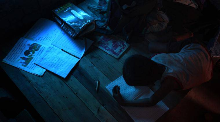 Shahid Hussain studying during his 'tuition' hours in the slums near Madanpur Khadar. Shahid is a Rohingya muslim and arrived in Delhi in 2012 after fleeing from his native country Myanmar. They went to Bangladesh first and arrived in Delhi in 2012. Express photo by Oinam Anand. 17 May 2015